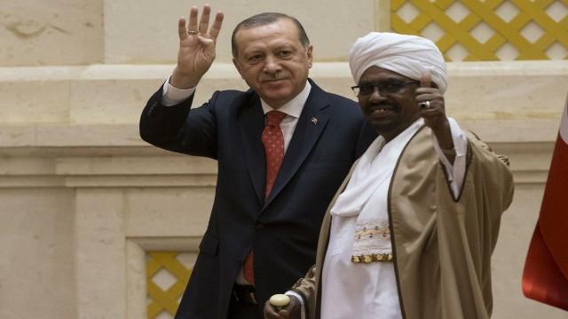 President of Turkey Recep Tayyip Erdogan (L) and President of Sudan Omar Al-Bashir (R)