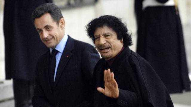 President Nicolas Sarkozy and former Muammar Gaddafi