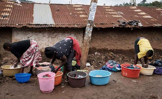 Women wash clothes