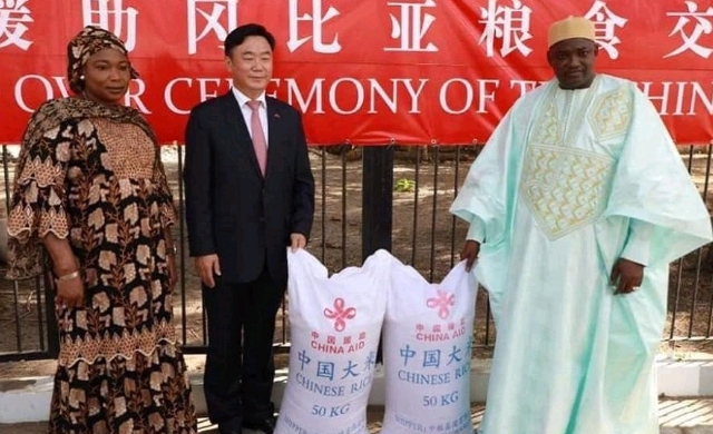 Adama Barrow (on the right) and  Chinese Ambassador