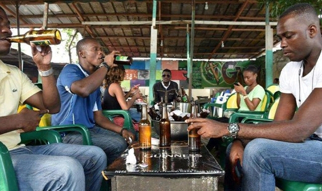 A group of young men consuming alcohol