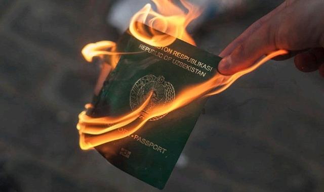 An Uzbekistani passport on fire